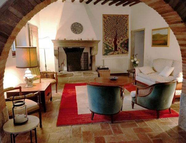 3-Le-Volpaie-living-room-fireplace